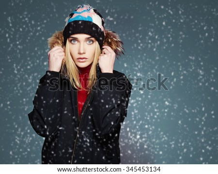 snowy winter style girl. fashion beautiful young woman in hat.frozen - stock photo