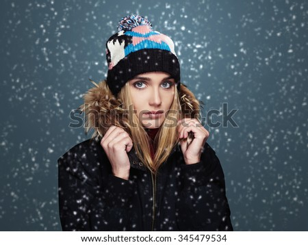 snowy winter style girl. fashion beautiful young woman in hat.happy winter time - stock photo
