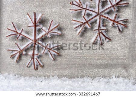 Snowy wooden stars as christmas greeting.