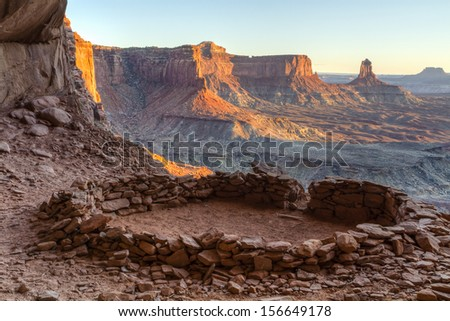 So-called 'False Kiva' class 2 archaeological site in Canyonlands National Park, with a view of Candlestick Tower in the Background - stock photo