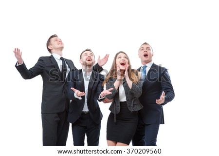 So exciting! Group of exciting businesspeople looking up and gesturing like catching something while expressing positivity. Isolated on white. - stock photo