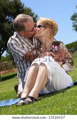 so in love! romantic senior couple kissing - stock photo