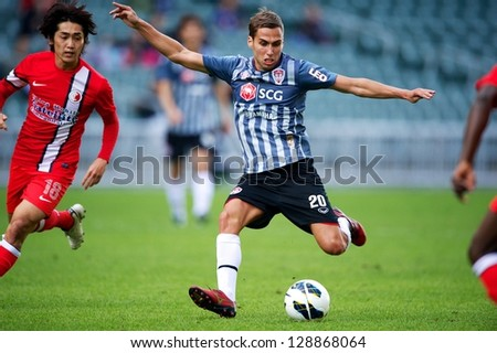 SO KON PO,HONG KONG-FEBRUARY13:Mario Gjurovski (R) of SCG MTUTD shoot the ball during the Lunar New Year Cup 2013 match between HK League and SCG MTUTD at Hong Kong Stadium on Feb13,2013 in,Hong Kong. - stock photo