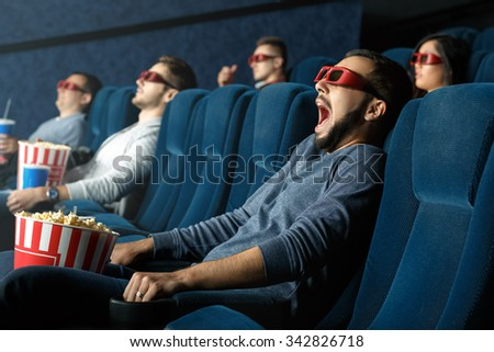 So realistic. Young man screaming as he is watching movie in his 3d glasses at the cinema