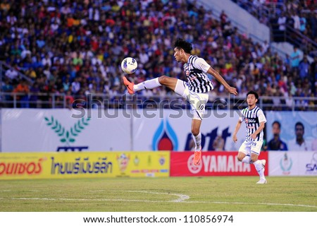 SOANGKHAL,THAILAND-5MAY:Teerasil Dangda (no.10)of SCG Muangthong Utd.in action duringThai Premier League between Wuachon Utd.and SCG Muangthong Utd.at Songkhla Stadium on May5,2012 in Thailand