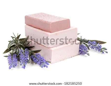 Soap and lavender flowers isolated on white background