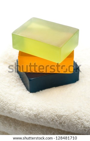 Soap and towels stacked - stock photo