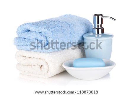 Soap and two towels. Isolated on white background - stock photo
