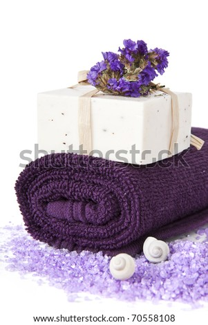 Soap Bars and violet towel with flower isolated. Bathroom composition - stock photo