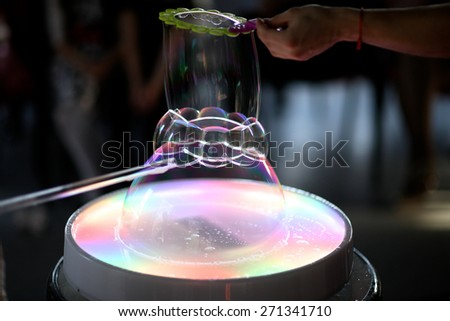 Soap bubble trick - stock photo