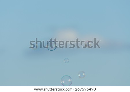 soap bubbles between the sky and clouds - stock photo