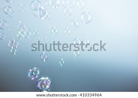Soap bubbles on gradation a blue background - stock photo