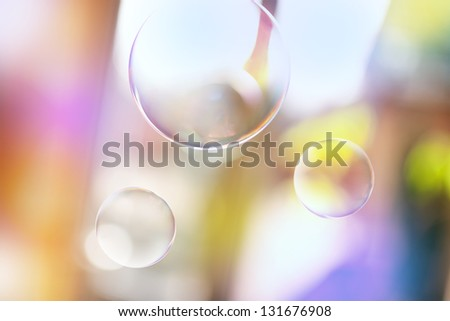 Soap bubbles on summer background - stock photo