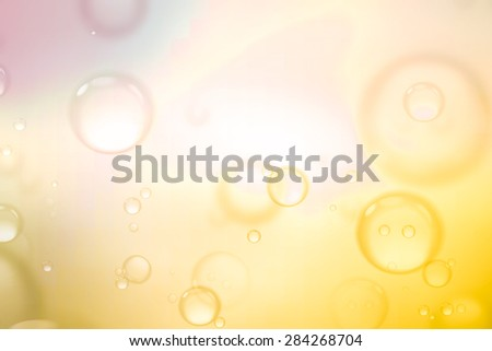 Soap bubbles on yellow background, abstract background.