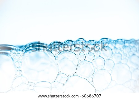 Soap bubbles. structure in a blue tonality. - stock photo