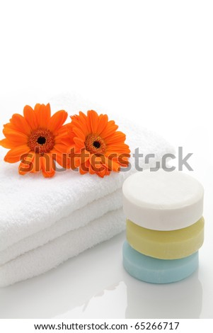 Soap, daisies and towel - stock photo