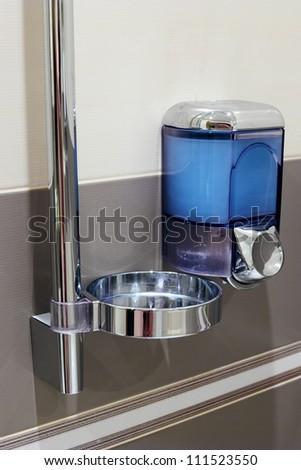 Soap dispenser in bathroom. - stock photo
