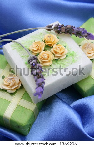 Soap gifts in yellow and green with fresh lavender - stock photo