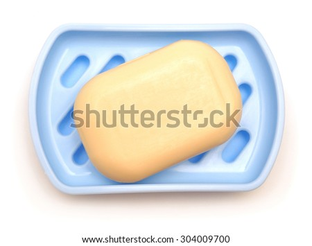 Soap in soap dish isolated on a white background - stock photo