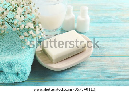 Soap on a dish over wooden background - stock photo