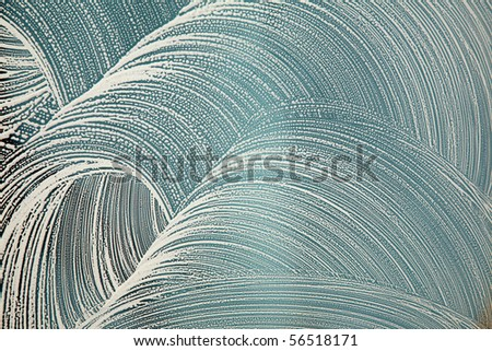 soap on a window for window washing or abstract background image use - stock photo