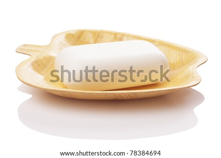 soap on soap dish isolated with path - stock photo