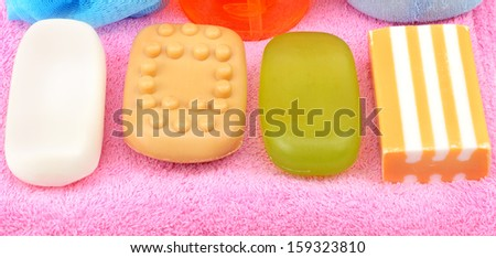 Soap on towel isolated on white background                                   - stock photo