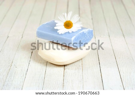 soap stack with chamomile flower on white wood table
