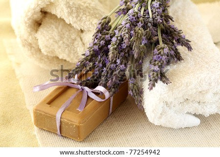 Soap ,towels and Lavender flowers - stock photo