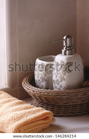 Soapbox and Bottle lay in The Basket, Bath towel lay near Soapbox ,Soft morning sun through The window. - stock photo