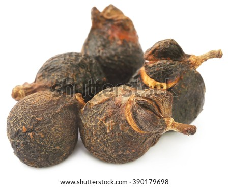Soapnuts or Soapberries used as natural surfactant over white background - stock photo