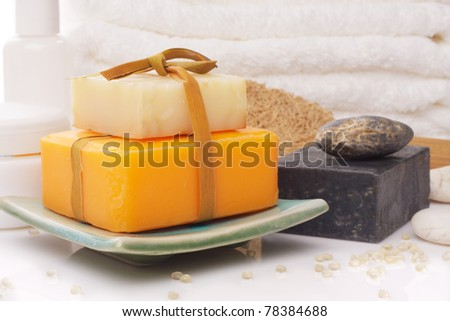 soaps on soap dish with accessory - stock photo