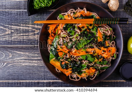 Soba noodles with vegetables and seaweed, top view. - stock photo