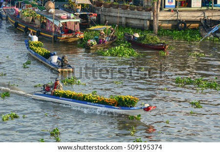 Soc Trang, Vietnam - Feb 2, 2016. People carrying flowers on river in Nga Nam, southern Vietnam. Nga Nam is one of famous market in southern Vietnam.