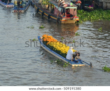 Soc Trang, Vietnam - Feb 2, 2016. People control motorboats on Nga Nam floating market in Soc Trang, southern Vietnam. Nga Nam is the local market of Mekong Delta, Vietnam