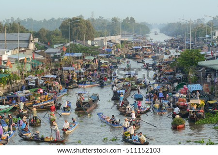 Soc Trang, Vietnam - Feb 2, 2016. People with wooden boats on Nga Nam floating market in Soc Trang, southern Vietnam.