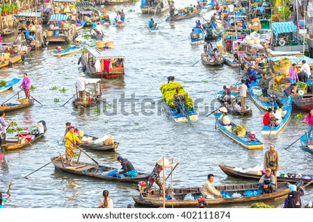 Soc Trang, Vietnam - February 3rd, 2016: Boat carrying daisies trade on river at the end of year around busiest boats agricultural trade makes scene more beautiful countryside in Soc Trang, Vietnam