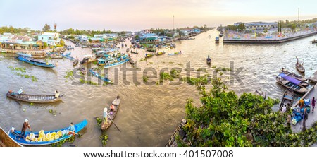 Soc Trang, Vietnam - February 3rd, 2016: Panorama floating market wetland busiest night with boats agricultural products to trade in morning preparing for New Year in wetland Soc Trang, Vietnam