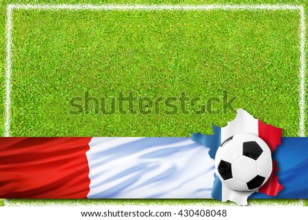 Soccer ball and french flag on green grass
