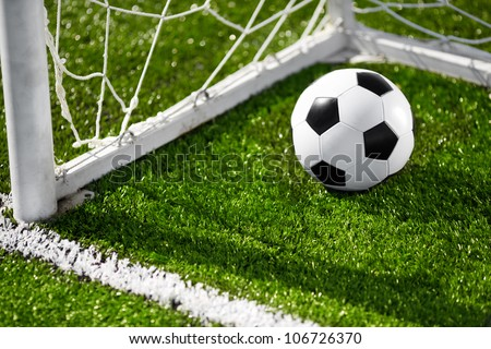 Soccer ball and goal net - stock photo