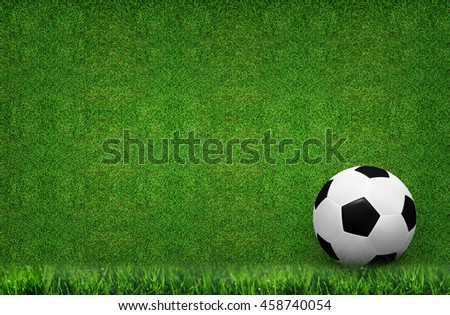 Soccer ball and green grass background.