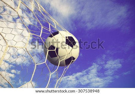soccer ball and sky background color vintage