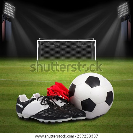 Soccer ball and soccer shoes on Soccer field
