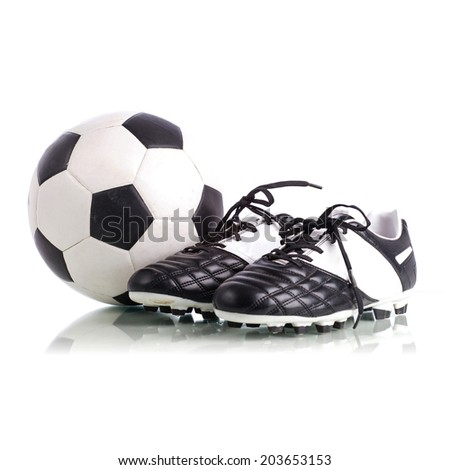 Soccer ball and soccer shoes on white background