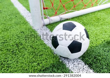 Soccer ball at line soccer goal. - stock photo