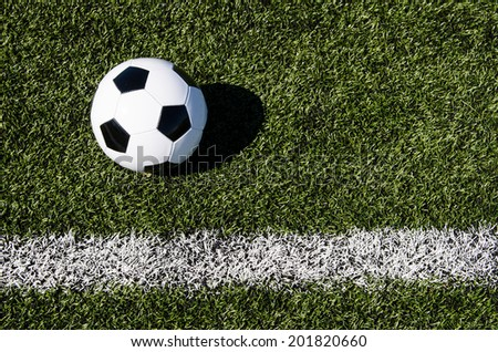 Soccer ball by boundary - stock photo