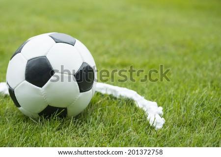 Soccer ball foam vanishing spray free kick line - stock photo