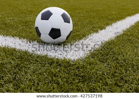 Soccer ball ,Football on artificial grass with white stripe in football stadium