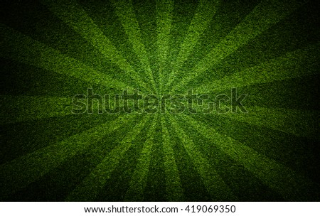 Soccer ball grass field with radial rays background - stock photo