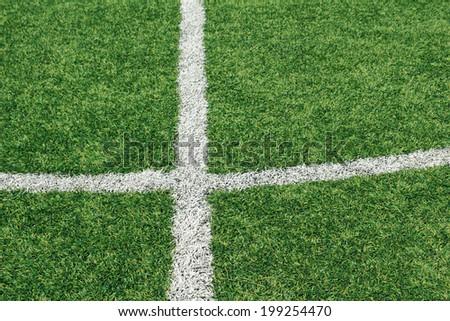 Soccer ball green grass field - stock photo